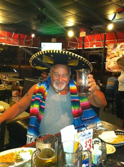 customer drinking a beer wearing a sombrero