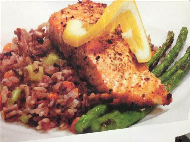 cooked fillet of fish with asparagus and rice