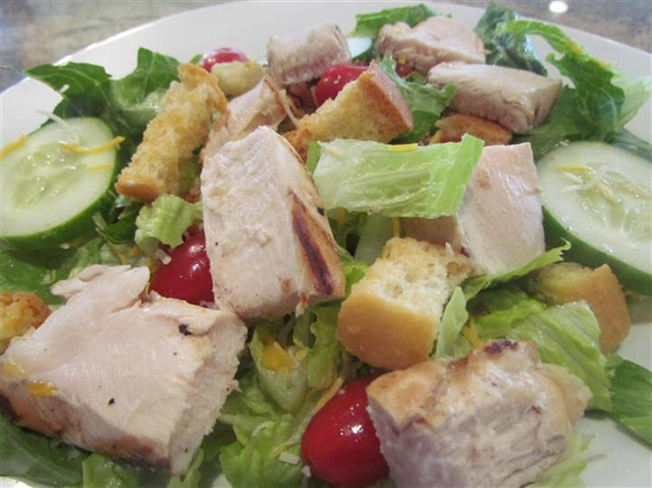 Salad with chicken, cherry tomatoes, and croutons.