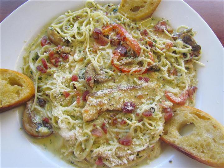 Linguini in a cream sauce with mushroom, red pepper and chicken.