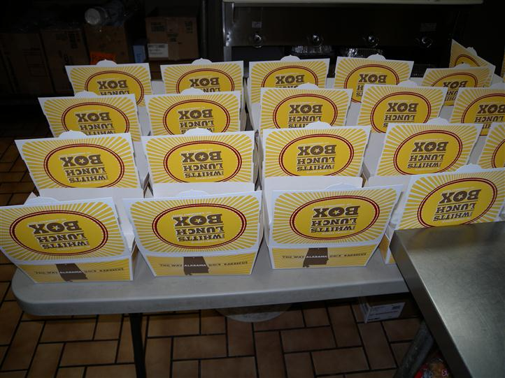 "a four-by-five row of boxes labelled ""Whitts Lunch Box"""