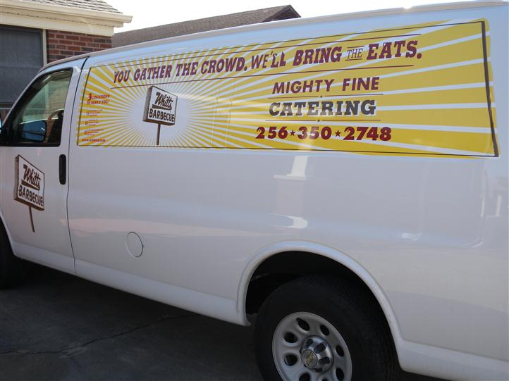 "a van with a sign on it that reads, ""You gather the crowd, we'll bring the eats. Mighty fine catering. 256-350-2748"""