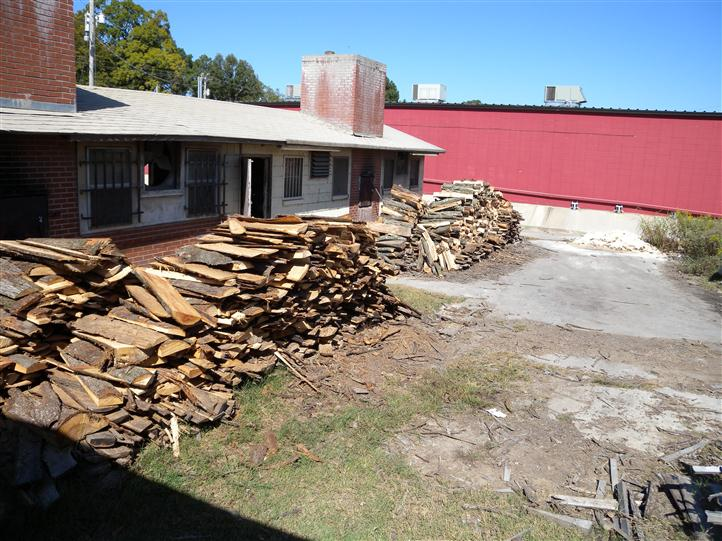 the back of the store, with four large stacks of split wood