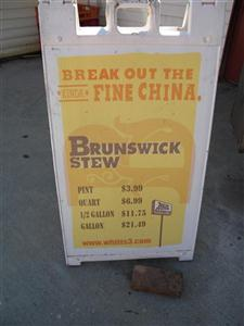 a collapsible floor stand menu, advertising Brunswick stew