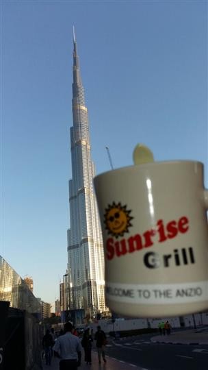 Sunrise Grill mug next to the burj khalifa