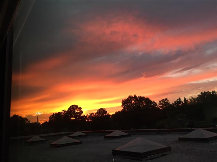 Photo of sunrise on roof top