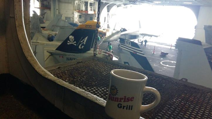 Sunrise grill mug in a airplane hangar