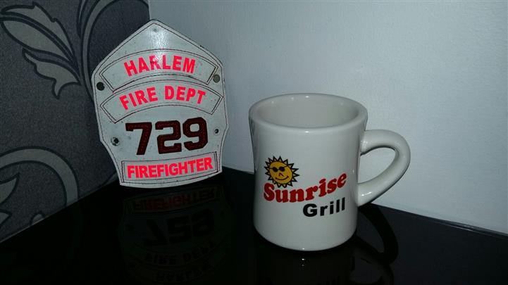 Sunrise Grill mug next to 729 Fire department