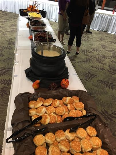 Soup in a cauldron and bread in baskets