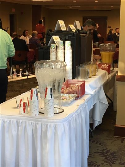 Cups set up on a catering table