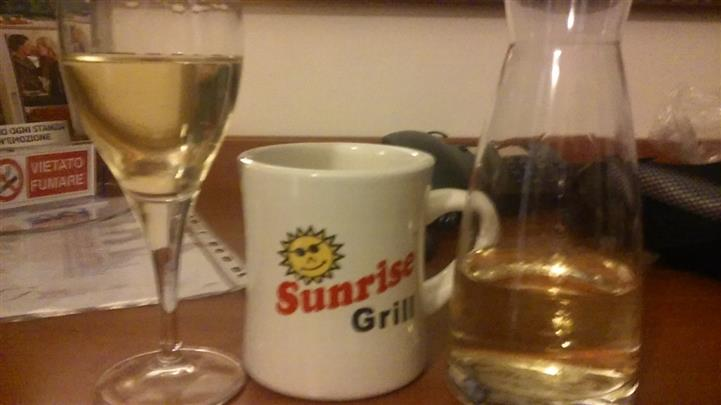 Sunrise grill mug next to a glass