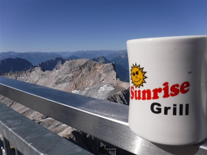 Sunrise grill mug with mountains in the background