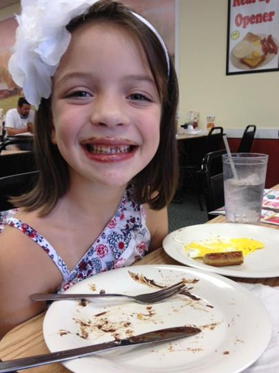 Child smiling with chocolate