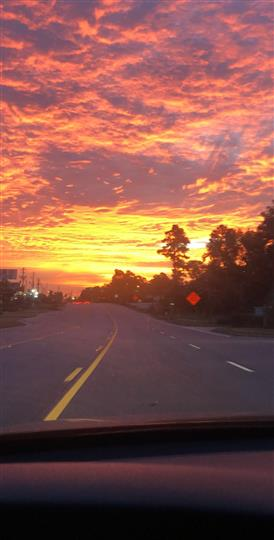 Sunrise over road