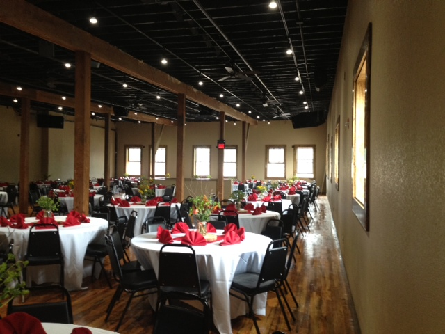 another view of the whole room that is set up for a wedding reception