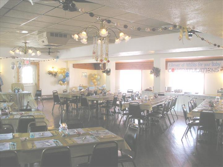 Event room decorated for a baby shower with colorful tables set for a party