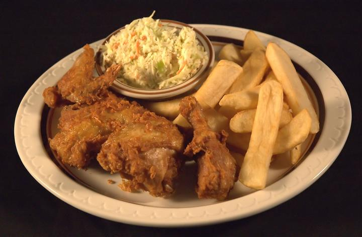 Chicken dinner served with fries and a side of cole slaw
