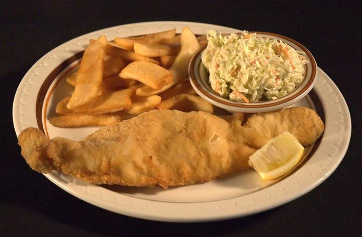 Fried Walleye fillet with a lemon wedge served with fries and a side of cole slaw