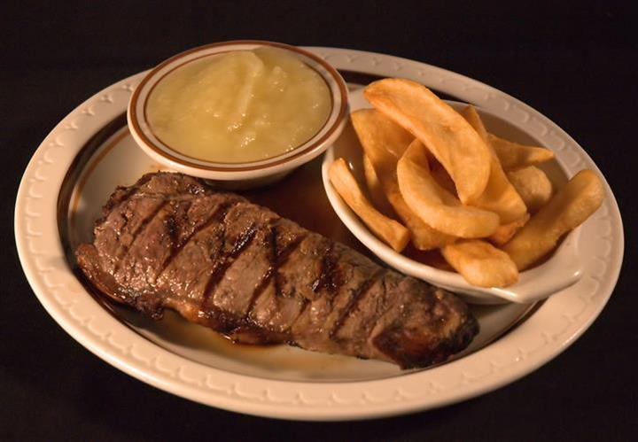 New York Cut Sirloin Steak served with fries and a side of sauce