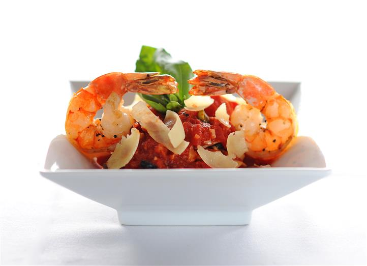 cooked shrimp in a bowl with vegetables