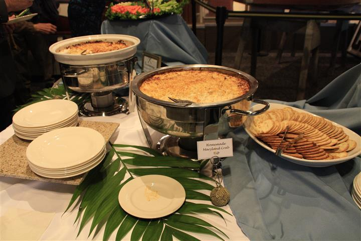 catering station with various food items and crackers