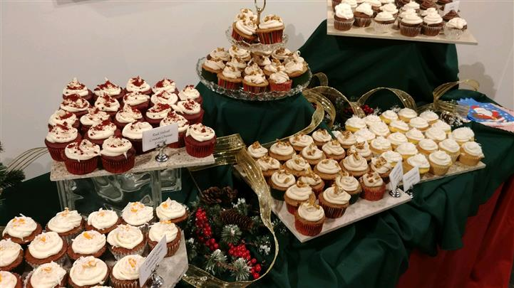 large dessert station with v arious cupcakes on display