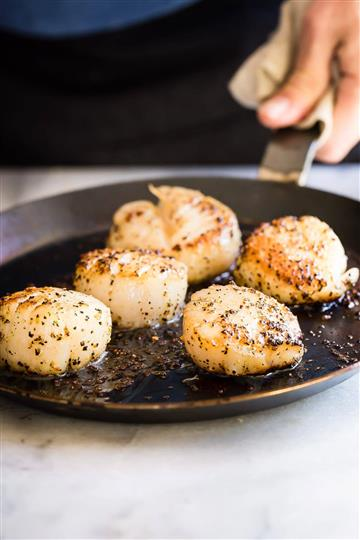 quinoa scallops fried in a pan