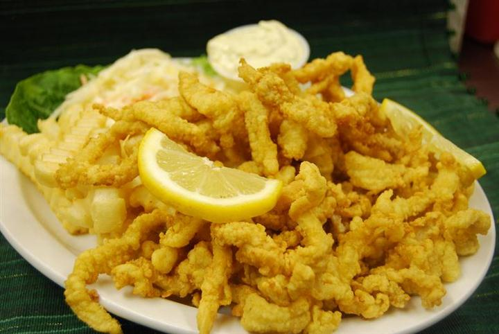 plate of fried calamari with a lemon wedge