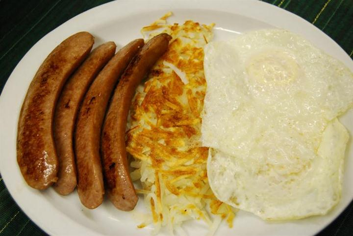 plate of eggs, sausage and hash browns
