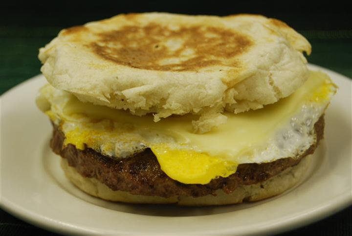 breakfast sandwich with eggs, cheese and sausage