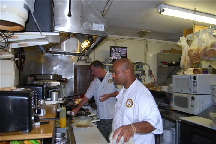 chefs in the kitchen preparing food