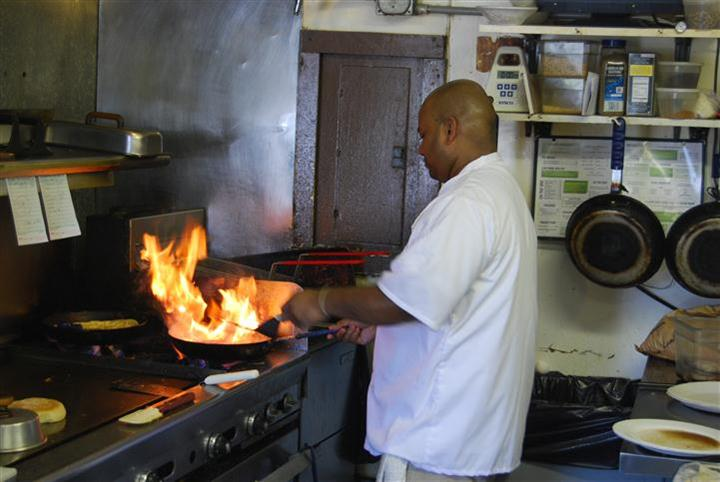 chef in the kitchen over an open flame