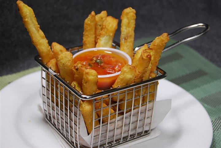 basket of french fries and dipping sauce