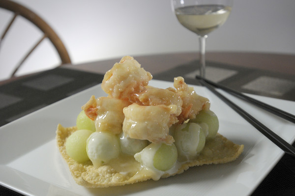 cooked shrimp in a fried wanton wrapper with a glass of wine