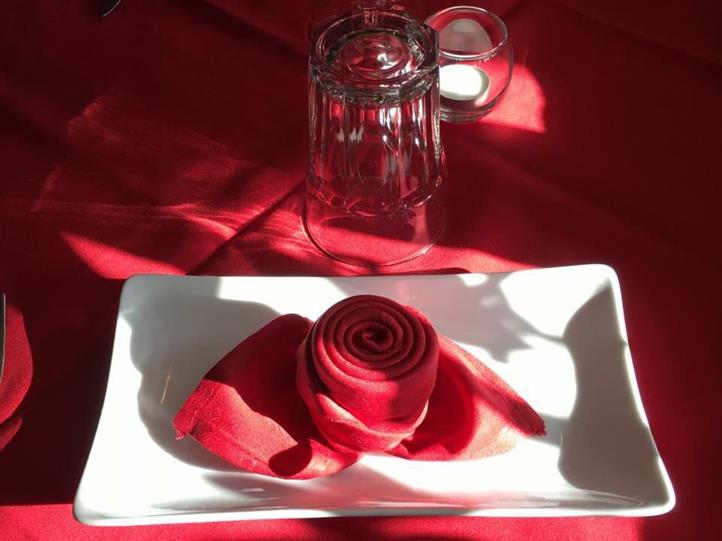 plate on table with rose petals