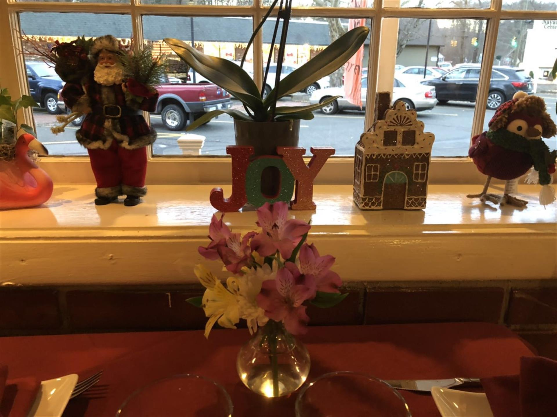 flowers on table next to window