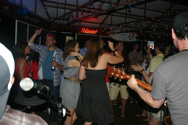People dancing to live music