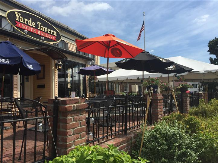 exterior gated entrance to the yarde tavern with an outdoor patio