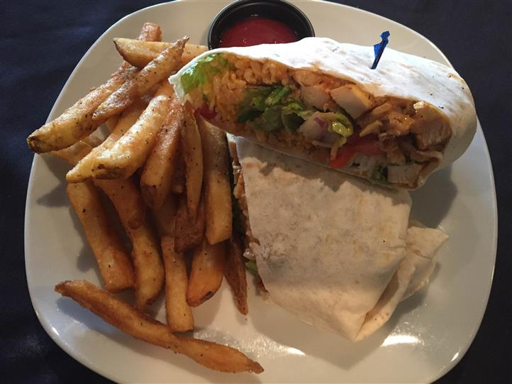 grilled chicken wrap with lettuce, tomatoes and a side of fries