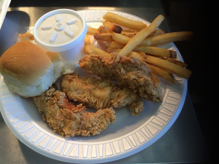 Fried chicken with rolls and fries