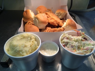 Box of fried chicken, rolls, potatoes and coleslaw