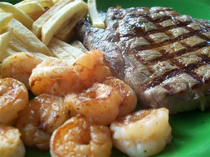 grilled steak with shrimp and french fries