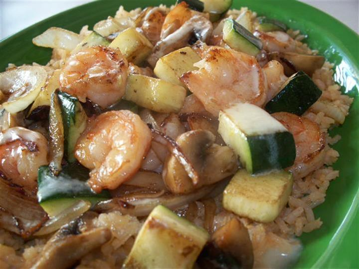 shrimp, mushrooms and zucchini over a bed of rice