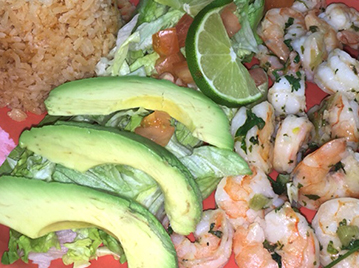 shrimp salad with sliced avocados and rice