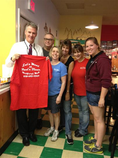 2 men and 4 women with a Paul's Diner red t-shirt posing for a photo.