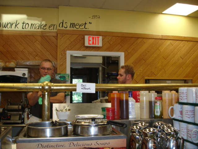 Interior shot of the restaurant with tow men behind the kitchen