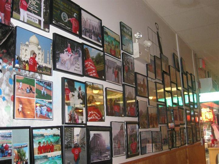 Interior shot of the restaurant's white wall with several photos
