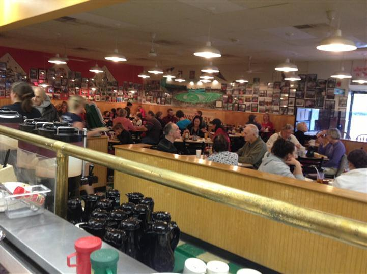 Interior shot of the restaurant full of people