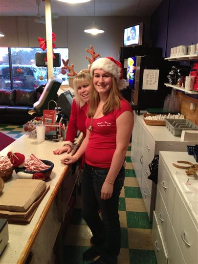 Two smiling waitresses in the restaurant at Christmas posing for a photo