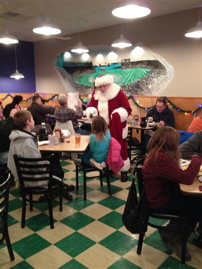 Photo of a Santa Claus giving gifts in the restaurant